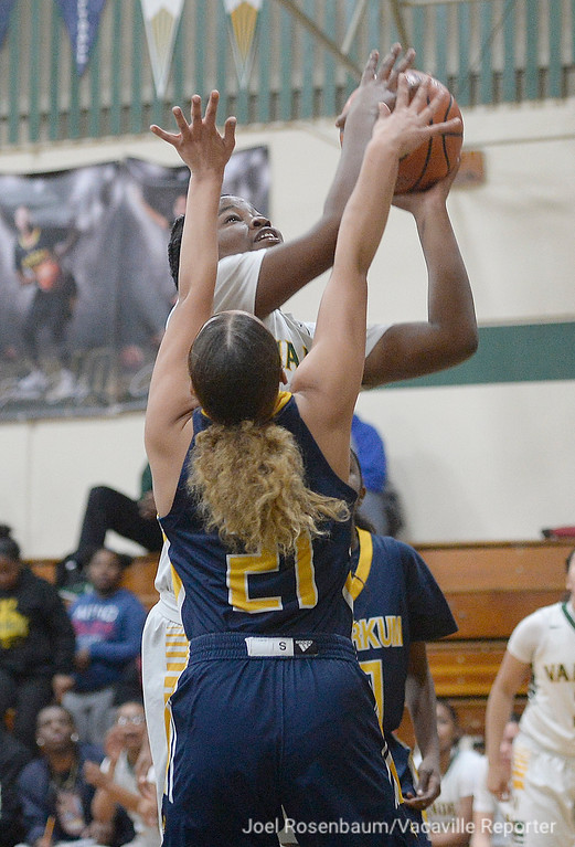 . Vanden\'s Jemai Bailey drives the basket through the pressure of Inderkum\'s Talieah Hedrick during the third quarter.
