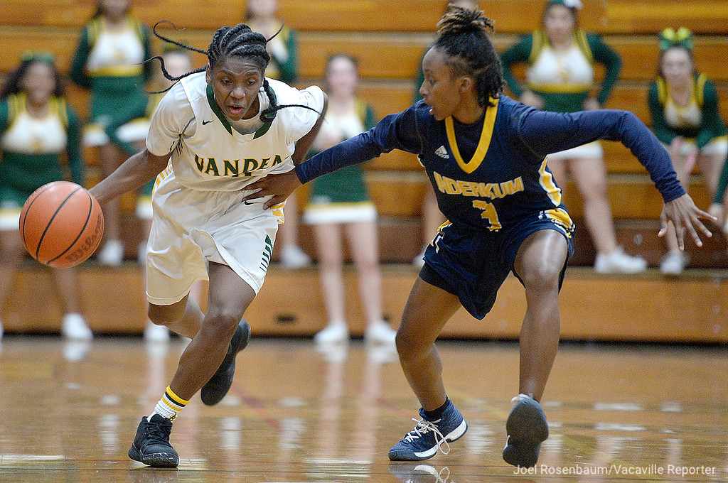 . Vanden\'s Deirdre Huff fights her way up court under pressure from Inderkum\'s Brooklyn Autry during overtime of the Vikings\' 71-66 overtime victory in the first round of the CIF Sac Joaquin Section Division II Championships.