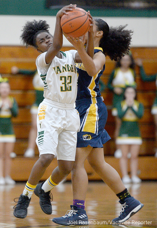 . Vanden\'s Rayonni Mack steals the ball from Inderkum High\'s Sidney Richards during the third quarter.