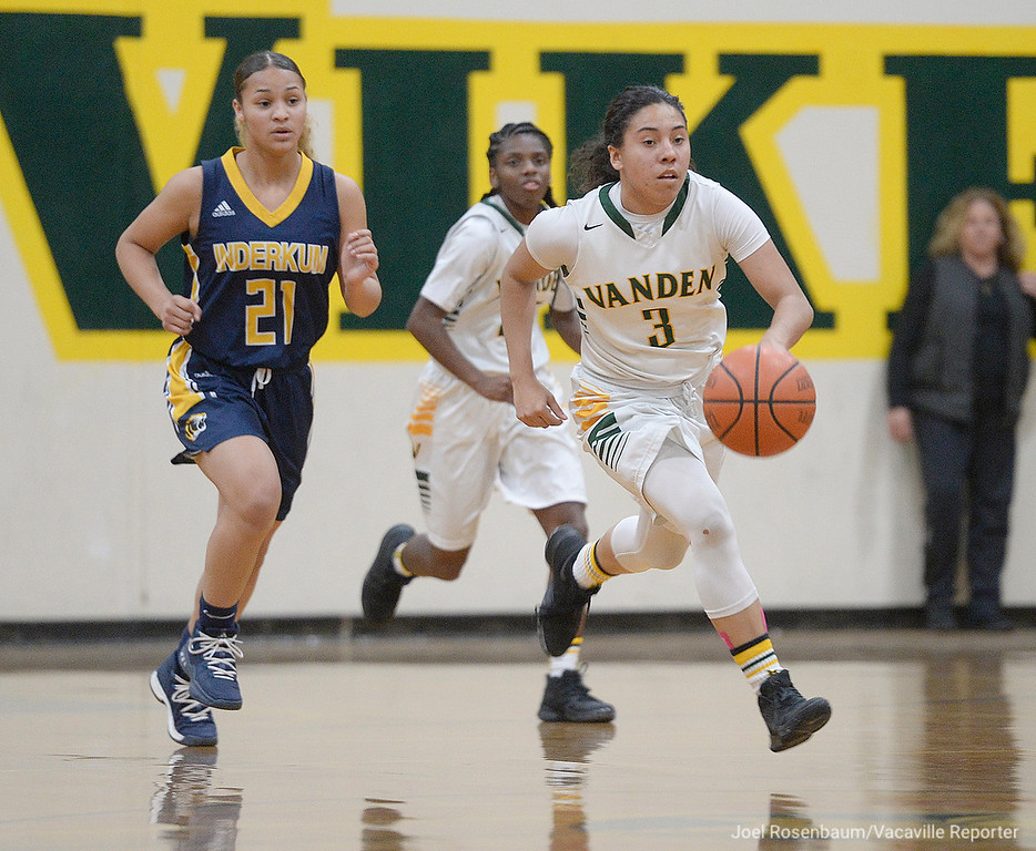. Vanden\'s Jenessa Herrera lead a fast break during the first  quarter of the Vikings\' 71-66 overtime victory in the first round of the 2018 CIF Sac Joaquin Section Division II Championships Tuesday at Jim Boyd Gymnasium.