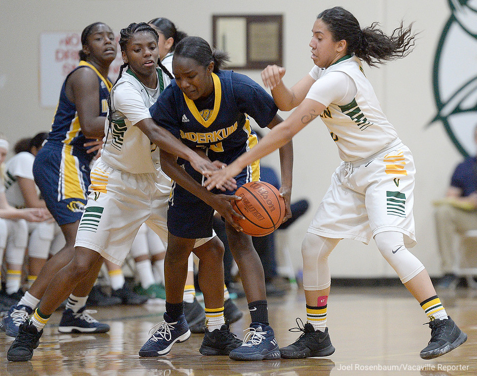 . Vanden\'s Deirdre Huff (left) and Jenessa Herrera double-team Inderkum High\'s Naomi Dillard during the second quarter of the Vikings 71-66 overtime victory in the first round of the 2018 CIF Sac Joaquin Section Division II Championships Tuesday at Jim Boyd Gymnasium.
