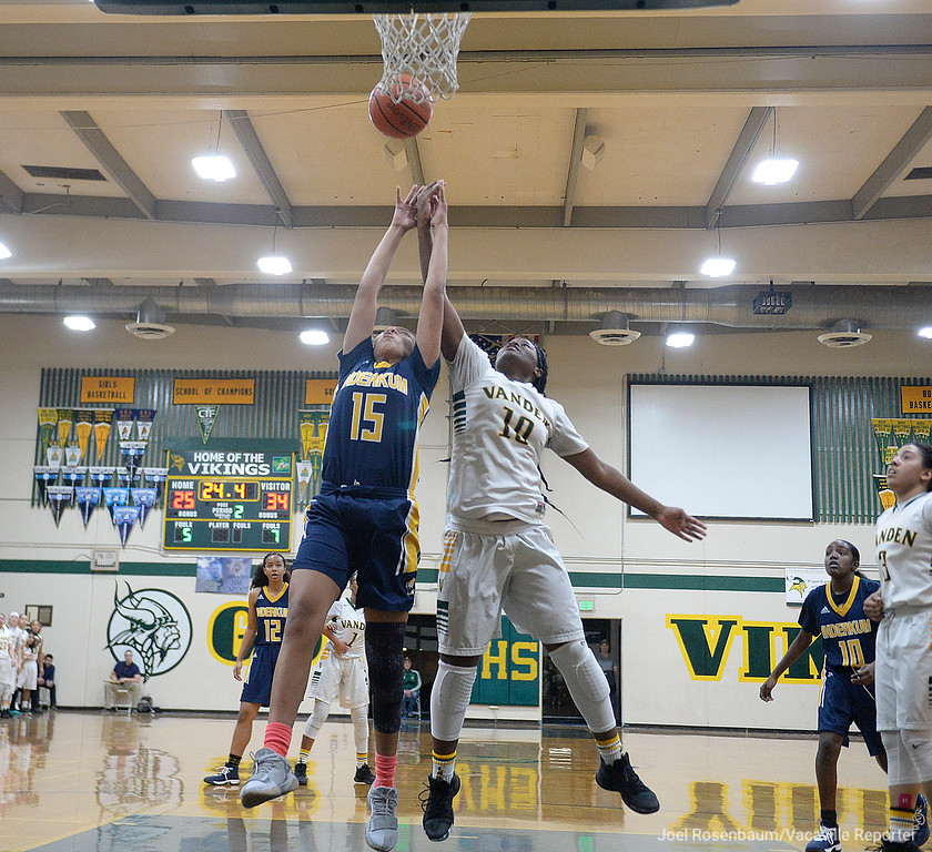 . Vanden\'s Jemai Bailey battles with Inderkum High\'s Joe\'l Benoit for a rebound late in the second quarter of the Vikings\' 71-66 overtime victory in the first round of the CIF Sac Joaquin Section Division II Championships.