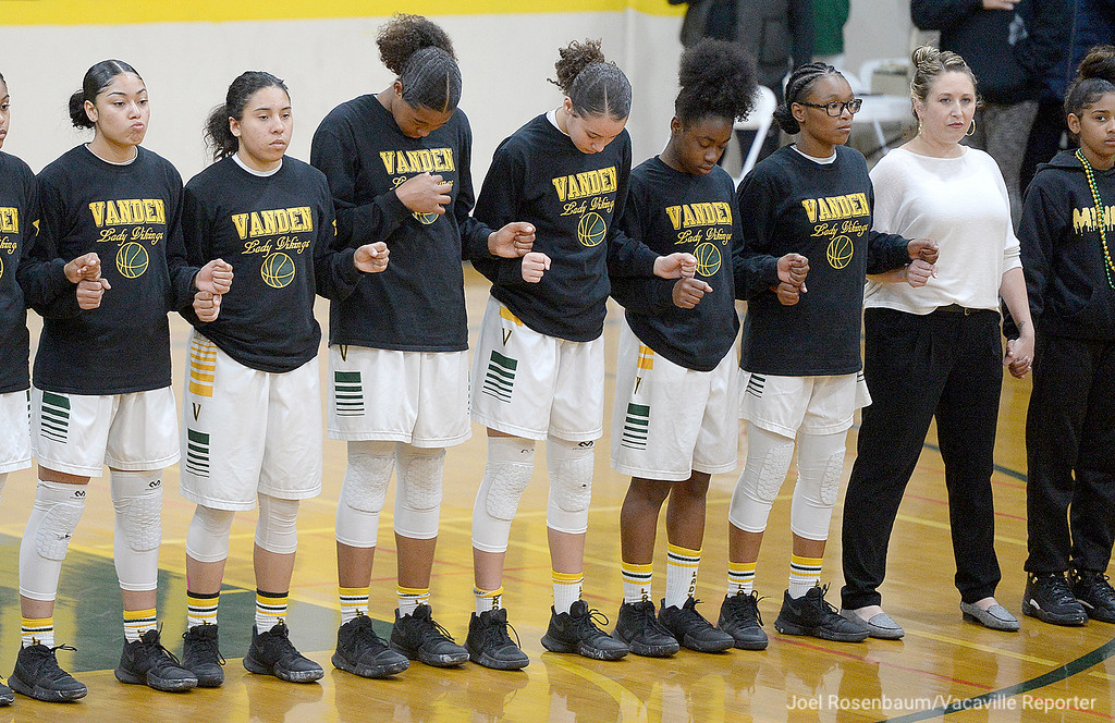 . Members of the Vanden High girls basketball team stand together as the national anthem is played before the tip off of their first round match up against Inderkum High School of Sacramento in the 2018 CIF Sac Joaquin Section Division II Championships Tuesday at Vanden.