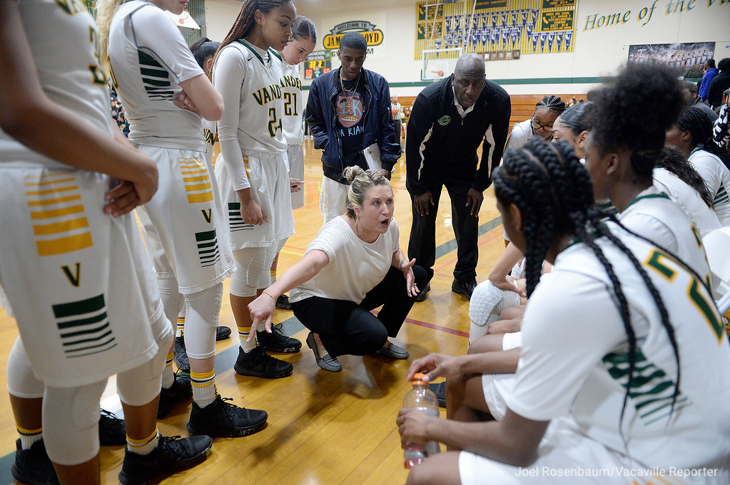 . Vanden head coaches Allison and Jake Johnson speak with their players late in the fourth quarter of the Vikings\' 71-66 overtime victory in the first round of the CIF Sac Joaquin Section Division II Championships.