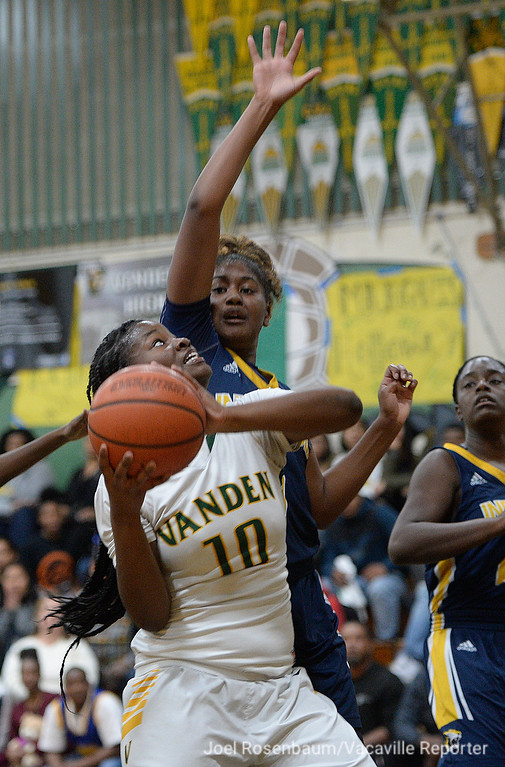 . Vanden\'s Jemai Bailey drives to the basket under pressure from Inderkum High\'s Shauna Jackson during the second  quarter of the Vikings\' 71-66 overtime victory in the first round of the 2018 CIF Sac Joaquin Section Division II Championships Tuesday at Jim Boyd Gymnasium.