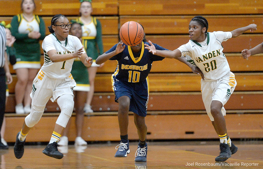 . Vanden\'s Tyliyah Grady (left) and Deirdre Huff chase down a loose ball during the fourth quarter of the Vikings\' 71-66 overtime victory in the first round of the CIF Sac Joaquin Section Division II Championships.
