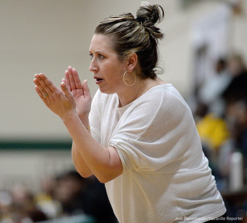 . Vanden High head coach,Allison Johnson cheers on her players late in the third quarter of the Vikings\' 71-66 overtime victory in the first round of the Sac Joaquin Section Division II Championships.
