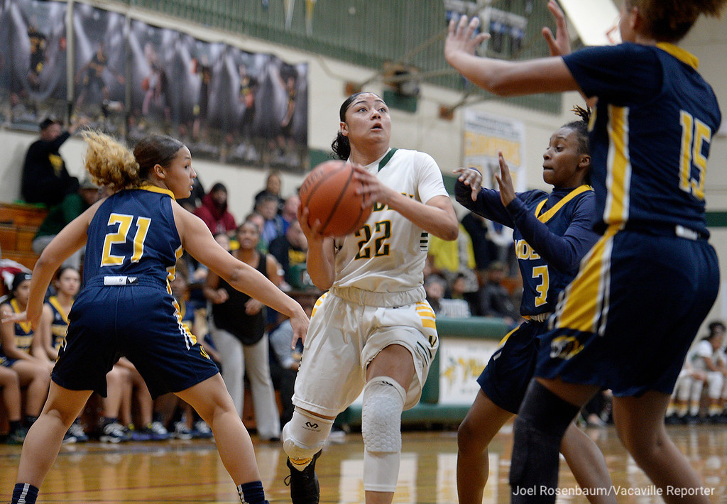 . Vanden\'s Myli Martinez drives through Inderkum High\'s Talieah Hedrick (left,) Brooklyn Autry (middle) and Joe\'l Benoit (right) during the second quarter of the Vikings 71-66 overtime victory in the first round of the 2018 CIF Sac Joaquin Section Division II Championships Tuesday at Jim Boyd Gymnasium.