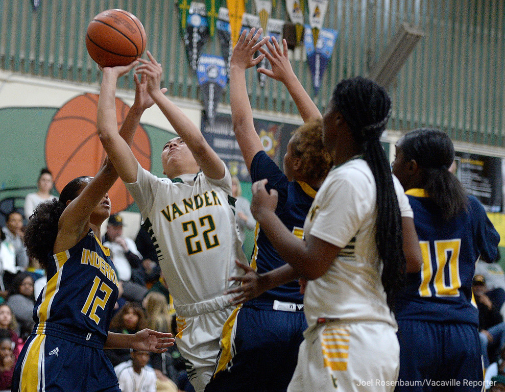 . Vanden\'s Myli Martinez drives through Inderkum\'s Sidney Richards (left,) Joe\'l Benoit (middle) and Naomi Dillard (rear) during the third quarter of the Vikings 71-66 overtime victory in the first round of the 2018 CIF Sac Joaquin Section Division II Championships Tuesday at Jim Boyd Gymnasium.