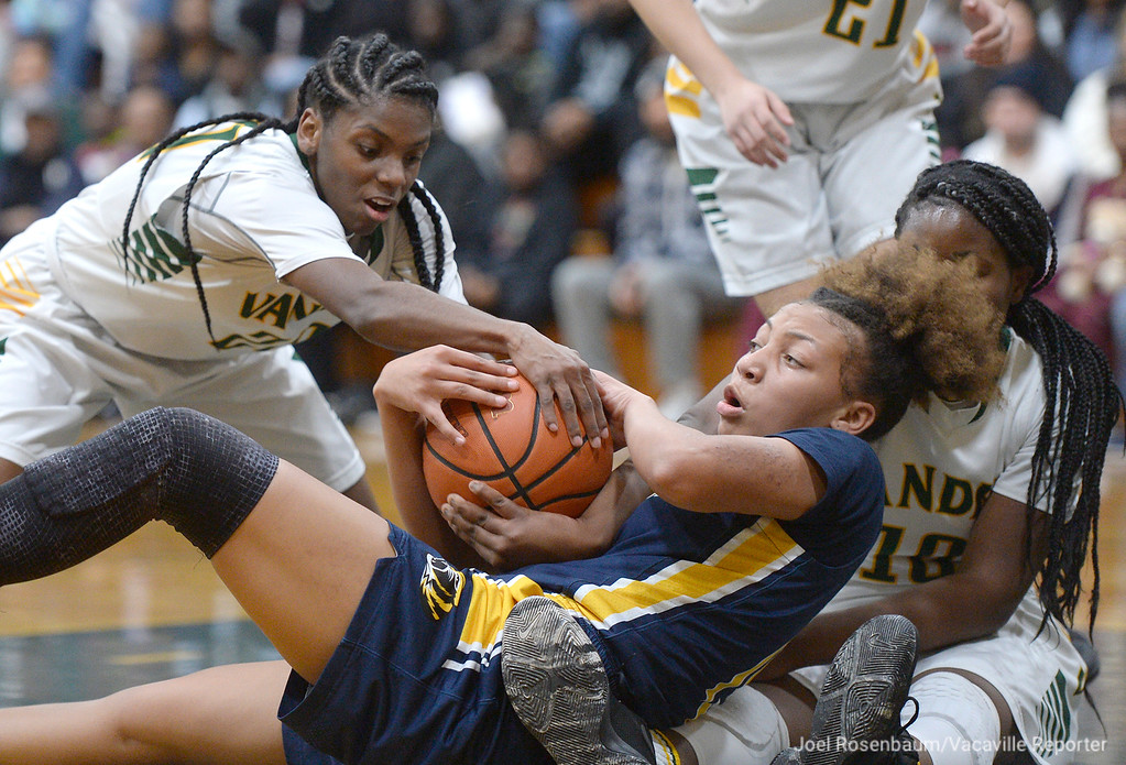 . Vanden\'s Deirdre Huff (left) and Jemai Bailey battle with Inderkum\'s Joe\'l Benoit for a loose ball during the second quarter of the Vikings\' 71-66 overtime victory in the first round of the 2018 CIF Sac Joaquin Section Division II Championships Tuesday at Jim Boyd Gymnasium.