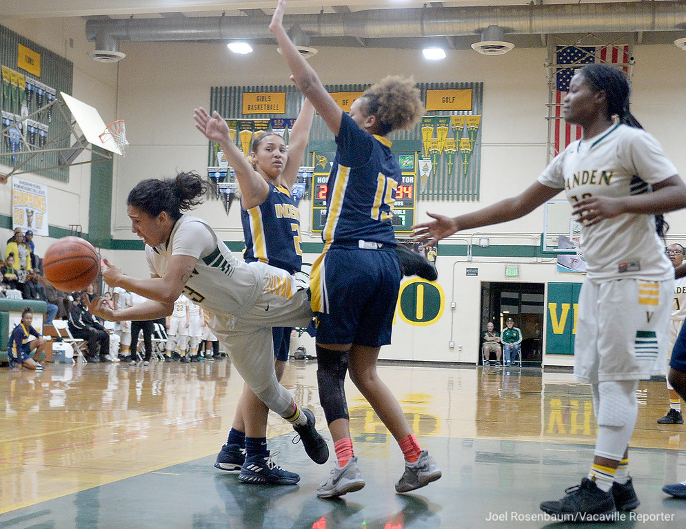 . Vanden\'s Jenessa Herrera is tripped up by Inderkum\'s Brooklyn Autry and Joe\'l Benoit as she drives the lane during the second quarter.