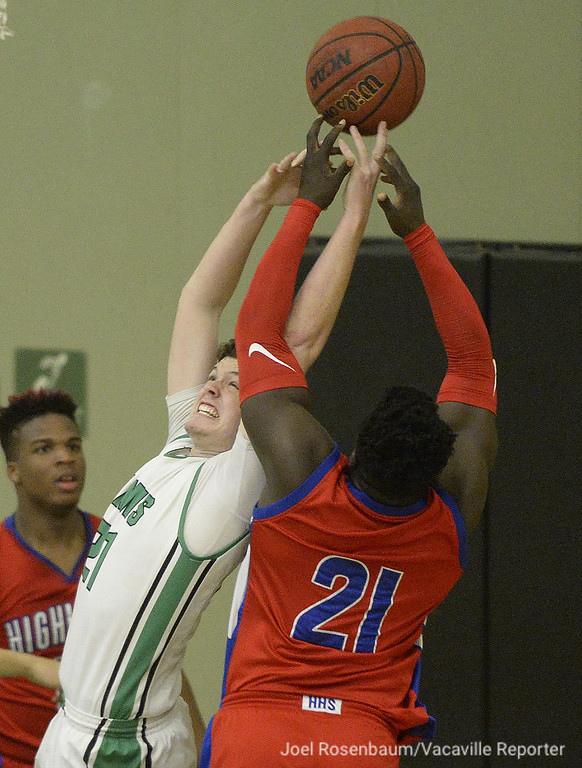 . Dixon High\'s Robert Nagle fights for a rebound with Highlands High School\'s Josh Cannon during the second quarter.
