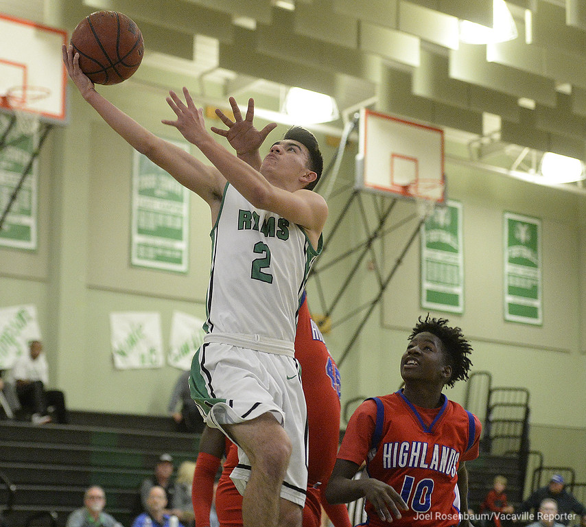 . Dixon High\'s Anthony Hatfield drives to the bucket past the pressure from Highland High School\'s Michael Hernandez second quarter of the Rams 81-44 rout of the Scots in the first round of the 2018 CIF Sac Joaquin Section Division IV Championships Wednesday at Dixon High School.