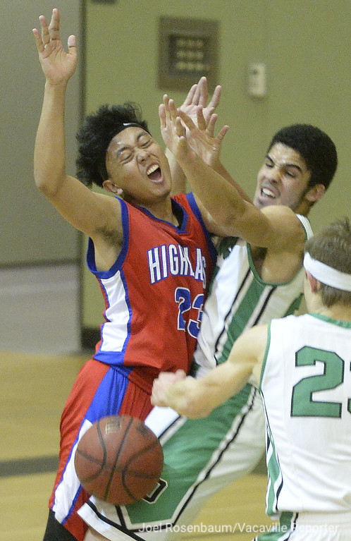 . Dixon\'s George Stewart knocks the ball away from Highlands High\'s Marcus Aurelio as they collide during the second quarter.