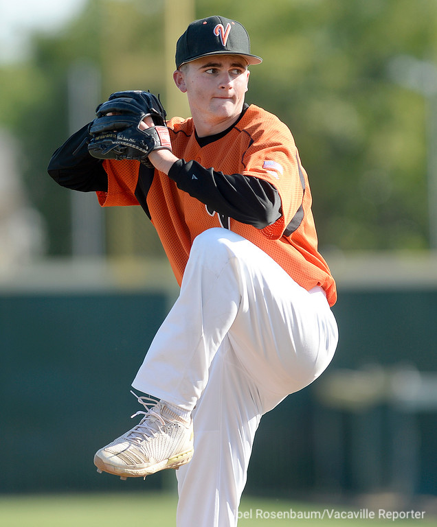 . Vacaville High\'s Brandon Chalk fires a pitch in the fifth inning. Chalk pitched five and a third of an inning giving up just three hits and allowing only one run earning the victory.