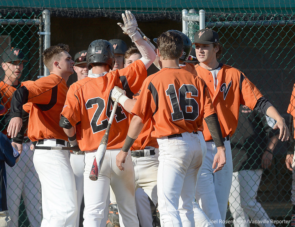 . Vaca High\'s Bryce Begell is mobbed by his teammates after hitting a solo home run in the seventh inning.