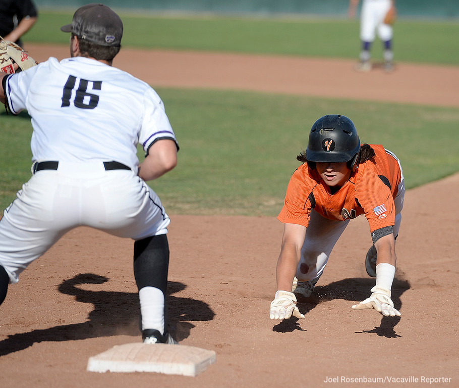 . Vaca High\'s Devereaux Harrison dives back toward first base on a pick off attempt in the seventh inning.