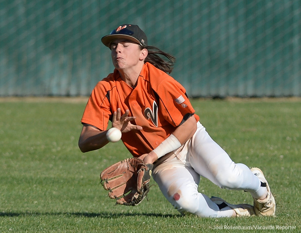 . Vaca High\'s Devereaux Harrison manages to keep a shallow fly ball in front of him to hold the Franklin High batter to a single during the sixth inning.