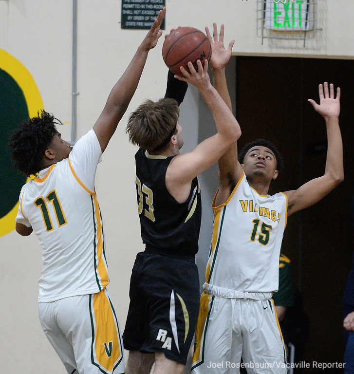 . Vanden\'s Jhaylon Martinez (left) and Teiano Hardee double team Kyle Astleford as he drives to the basket during the first quarter in the quarterfinals of the 2018 CIF Sac Joaquin Section Division III Championships Friday at James Boyd Gymnasium.