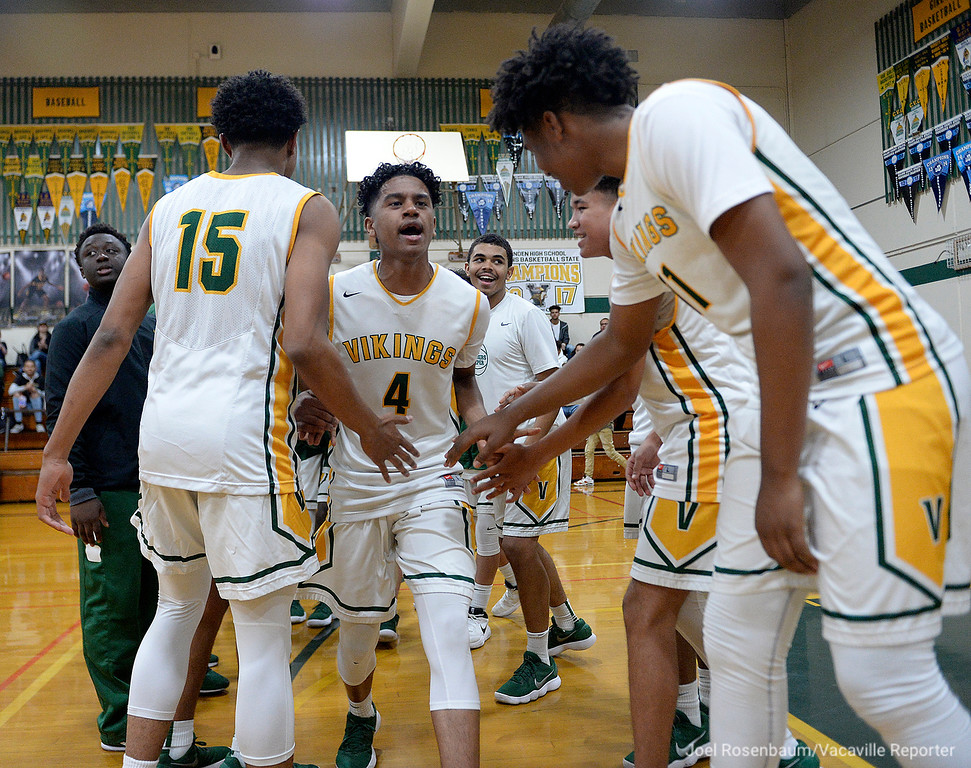 . Vanden\'s Aaron Porcil runs through his teammates as he is introduced before tip off  of their second round match up against Rio Americano High in the 2018 CIF Sac Joaquin Section Division III Championships.