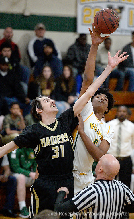 . Vanden High\'s Jhaylon Martinez challenges Rio Americano High\'s Jonah Roth for the opening tip of their second round match up against Rio Americano High in the 2018 CIF Sac Joaquin Section Division III Championships.