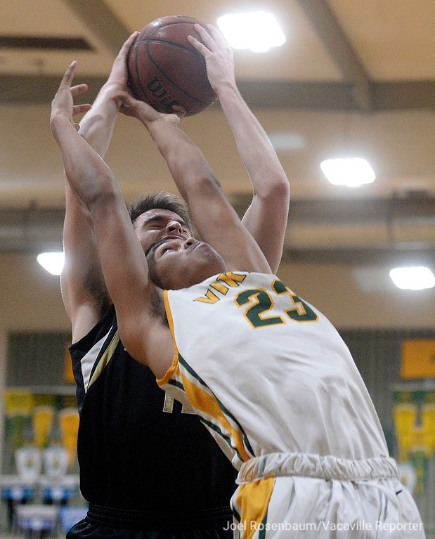 . Vanden High\'s Nathan Swift battles with Rio Americano\'s Matt Dixon for a rebound during the second quarteri in the quarterfinals of the 2018 CIF Sac Joaquin Section Division III Championships Friday at James Boyd Gymnasium.
