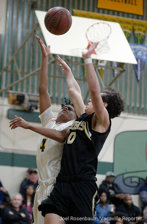 . Vanden High\'s Aaron Porcil drives to the basket under pressure from Rio Americano Highs\' Jake Paxton during the third quarter of their upset loss in the quarterfinals of the 2018 CIF Sac Joaquin Section Division IV Championships Friday at James Boyd Gymnasium.
