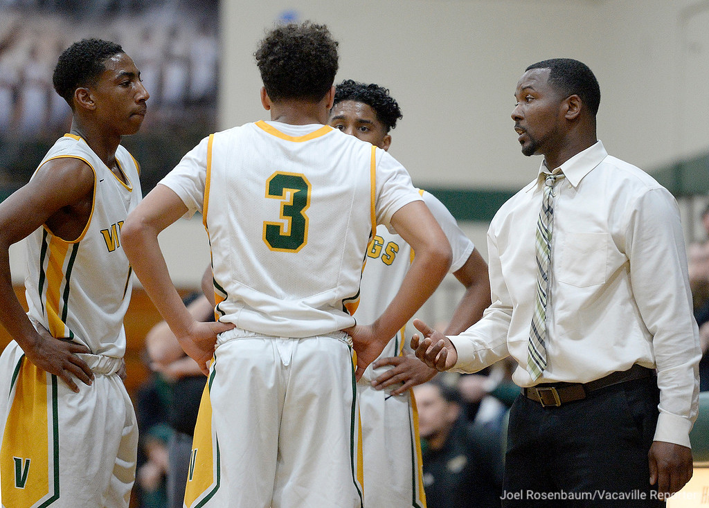 . Vanden High head coach, Micheal Holloway speaks with his players during a break in the action in the third quarter.