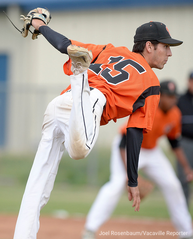 . Vacaville High\'s Austin Lamb follow through after making a pitch during he first inning of the Bulldogs\' 10-4 victory over Jesuit High School  in the semi-finals of the 2018 CIF Sac-Joaquin Section Division I Championships Friday at Davis High School. Lamb gave up three hits, striking out five and gave up just one run over five innings of work to pick up the win.