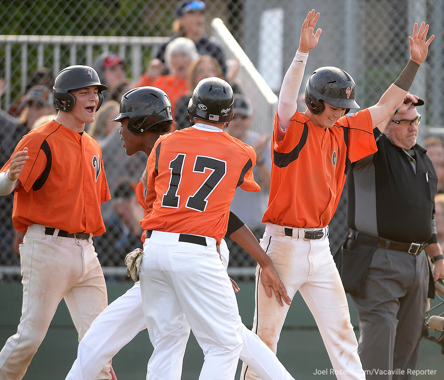 . Vaca High\'s Adam Chadwick (left) celebrates with Michael Brown, Cole Elvis and Bryce Begell after they scored on teammates Noah McCoy\'s bases clearing double in the fifth inning.