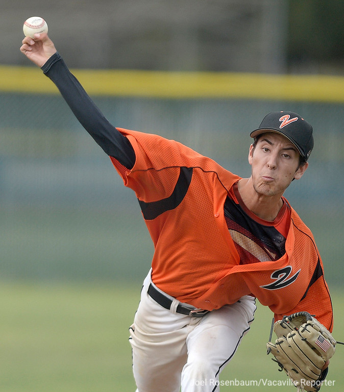. Vacaville High\'s Austin Lamb fires a pitch during he second inning of the Bulldogs\' 10-4 victory over Jesuit High School  in the semi-finals of the 2018 CIF Sac-Joaquin Section Division I Championships Friday at Davis High School. Lamb gave up three hits, striking out five and gave up just one run over five innings of work to pick up the win.