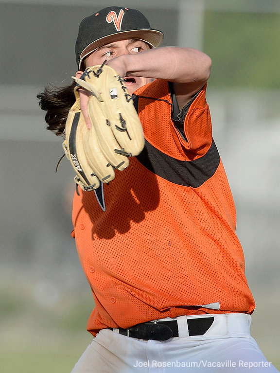 . Vacaville High\'s Devereaux Harrison fires a pitch during he sixth inning of the Bulldogs\' 10-4 victory over Jesuit High School  in the semi-finals of the 2018 CIF Sac-Joaquin Section Division I Championships Friday at Davis High School.