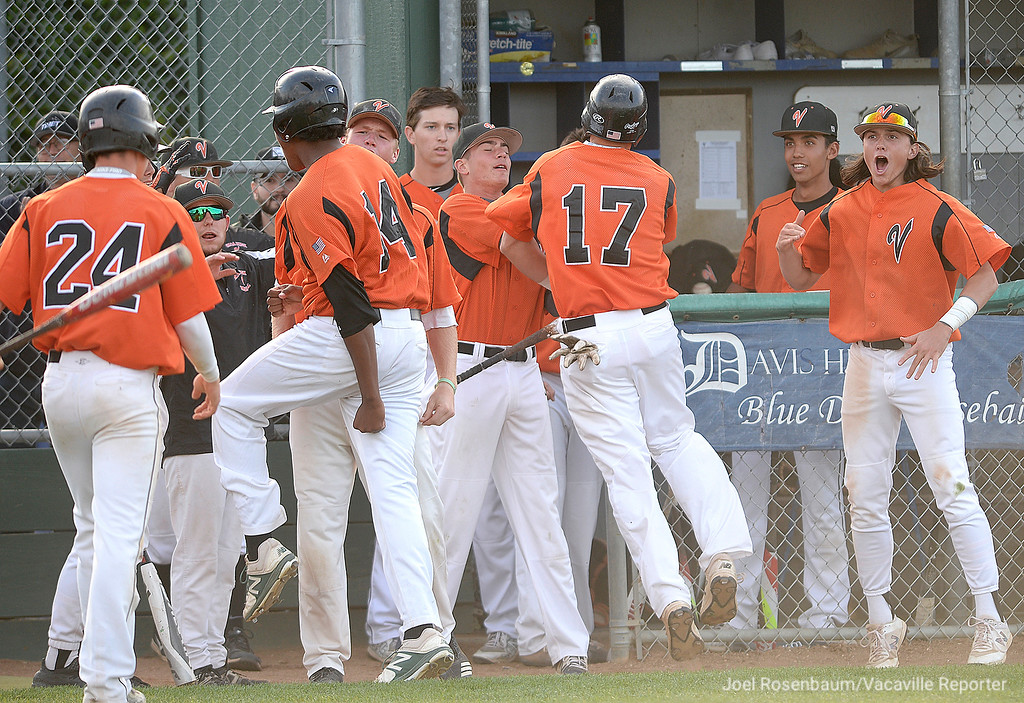 . The Bulldog bench erupts after Noah McCoy smashed a bases clearing double with two outs in the fifth inning of the \'Dogs 10-4 victory 10-4 victory over Jesuit High School in the semi-finals of the 2018 CIF Sac-Joaquin Section Division I Championships Friday at Davis High School.