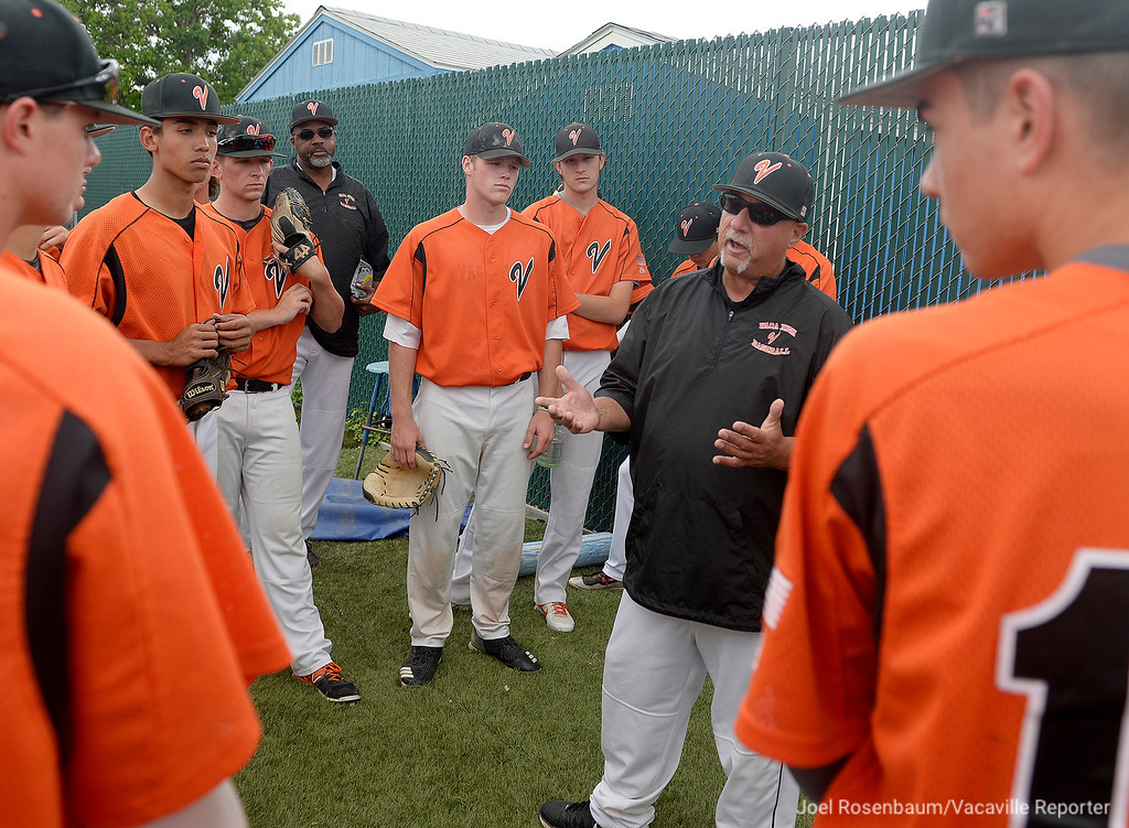 . Vacaville High head coach Stu Clary holds a pregame meeting with his players before their semi-final showdown with Jesuit High School Friday at Davis High School.