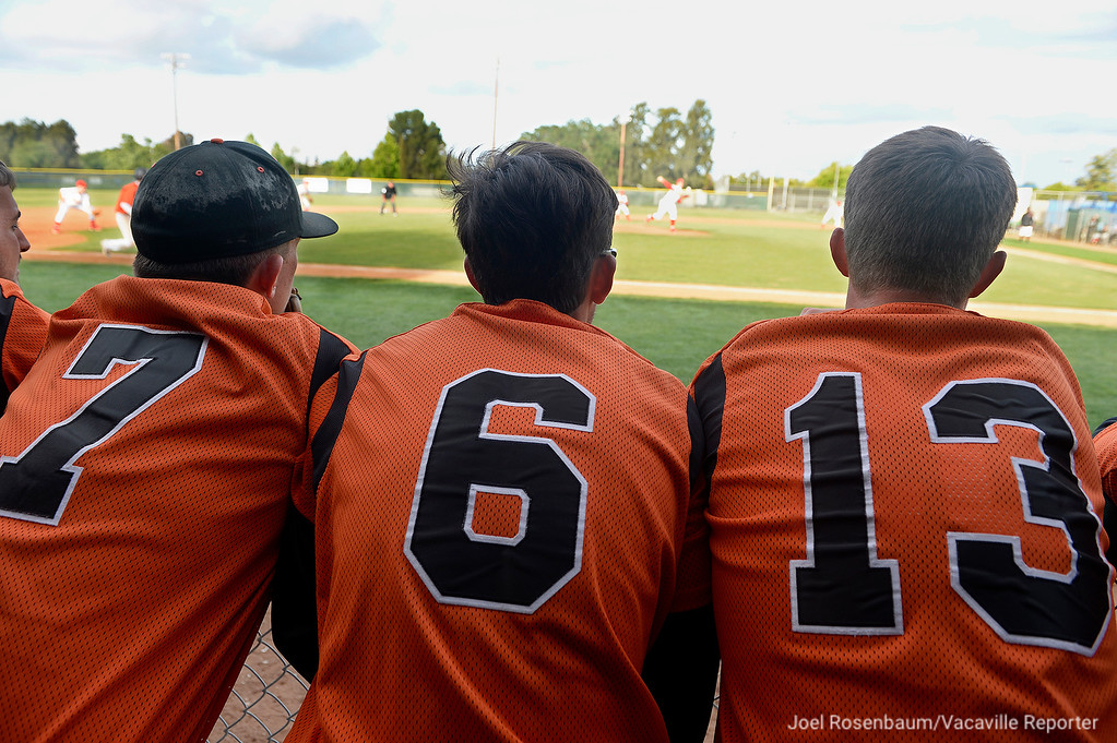 . Vaca High\'s Carson Knutson (7,) Thomas Gentry (6,) and Alex Paschal watch sixth inning action.
