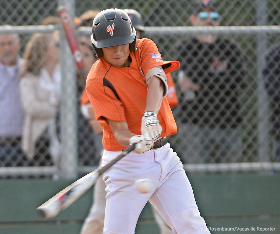. Vacaville High\'s Noah McCoy smashes a bases clearing double with two outs in the fifth inning to put the Bulldogs up 5-1 in their section semi-final victory over Jesuit High School at Davis High School.