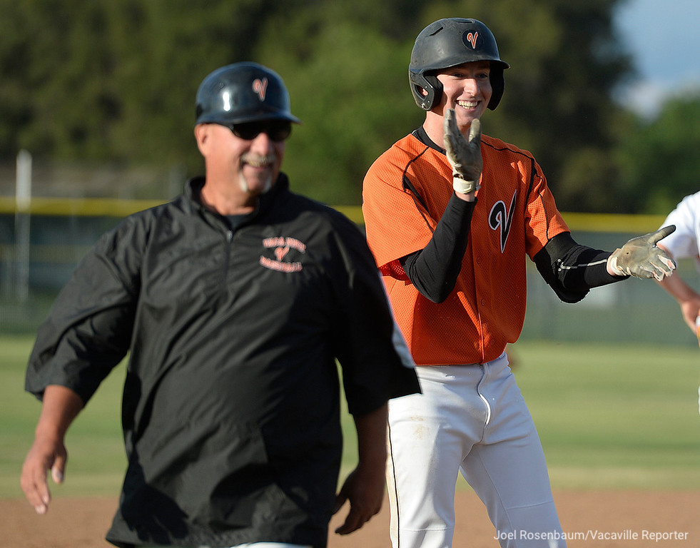 . Vaca\'s TJ Smith (right) and head coach, Stu Clary react to the cheers of his teammate after his sixth inning triple.