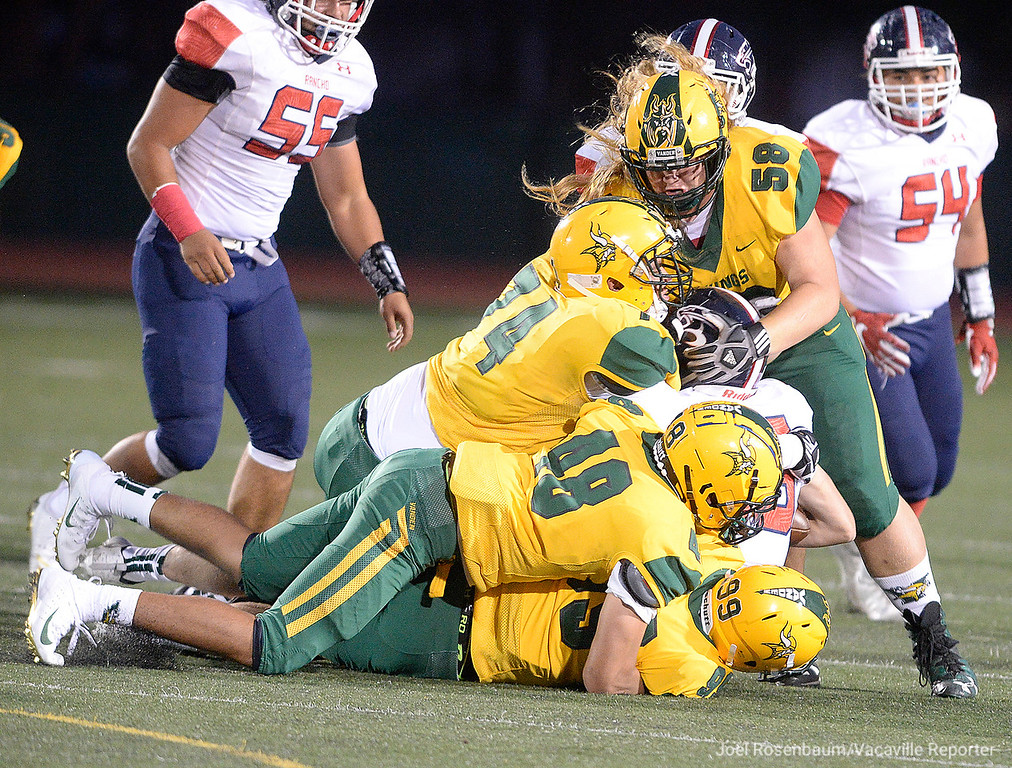 . Members of the Vanden High defense, Rory Creighton (99,) Samuelu Siaosi (48,) Michael Anchante (74) and Jonah Ramos (56) smother Rancho Cotate quarterback. Jared Stocker during the second quarter.