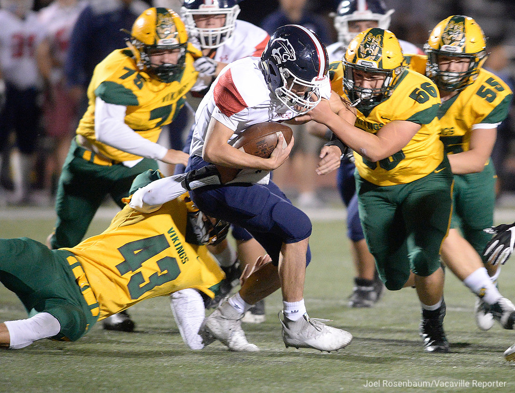 . Vanden linebackers Xavier Rios (left) and  Jonah Ramos sack Rancho Cotate quarterback. Jared Stocker during the second quarter.