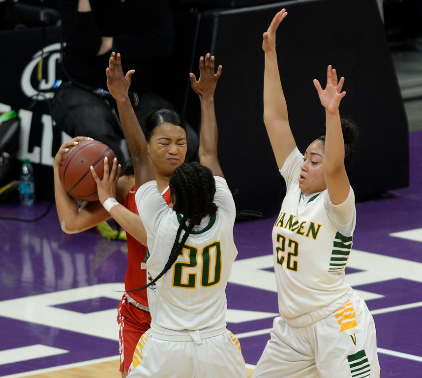 . Vanden�s Deirdre Huff (20) and Myli Martinez double-team Mater Dei�s Nicole Freeman during the second quarter of the Lady Vikings state title victory. Joel Rosenbaum -- The Reporter
