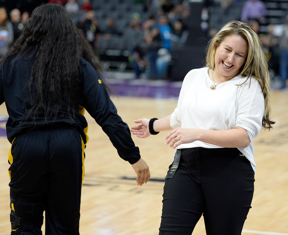 . Vanden High co-head coach, Allison Johnson laughs as her players are introduced during the awards ceremony. Joel Rosenbaum -- The Reporter
