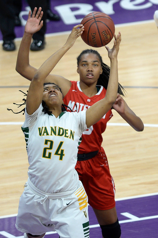 . Vanden\'s Kaelee Campbell pulls down an offensive rebound in front of Mater Dei\'s Cyndi Lewis during the second quarter. Joel Rosenbaum -- The Reporter