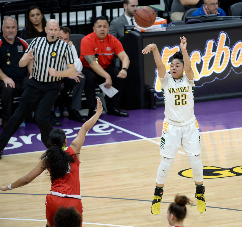 . Vanden\'s Myli Martinez fires a three-pointer during the second quarter. Huff finished with 12 points in the Vikings 64-61 victory in the CIF State Girls Division II Championships. Joel Rosenbaum -- The Reporter