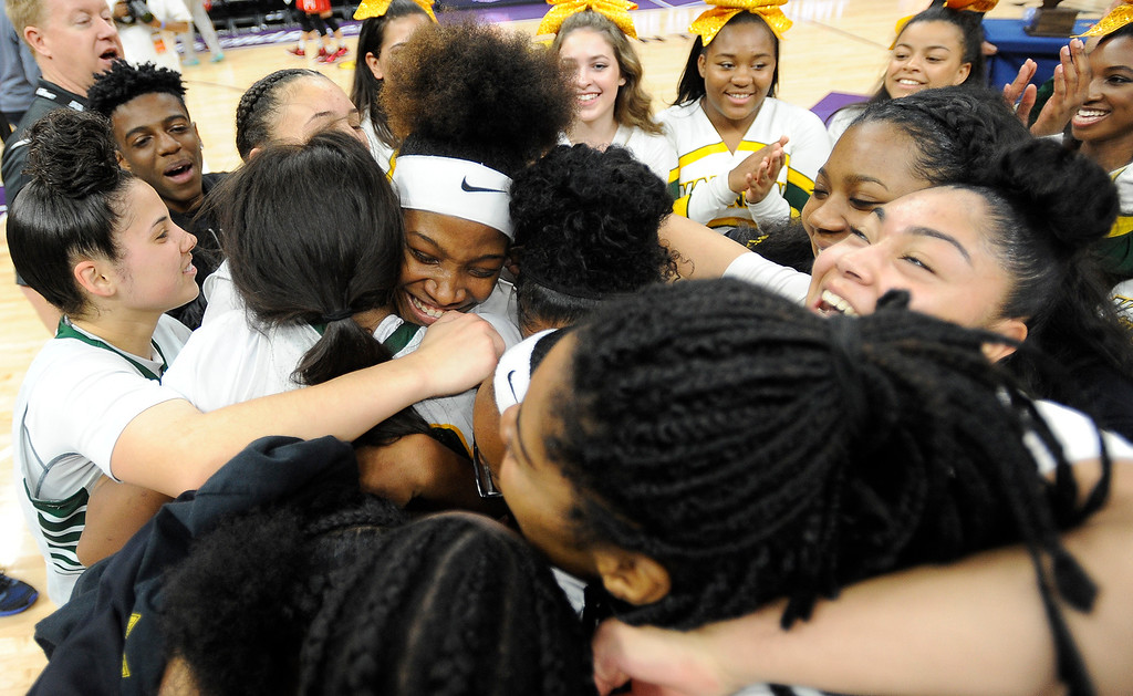 . Members of the Vanden Vikings girl basketball team celebrate their 64-61 victory over Mater Dei High School in the CIF Girls Division II State Championship Saturday at the Golden 1 Center in Sacramento. Joel Rosenbaum -- The Reporter