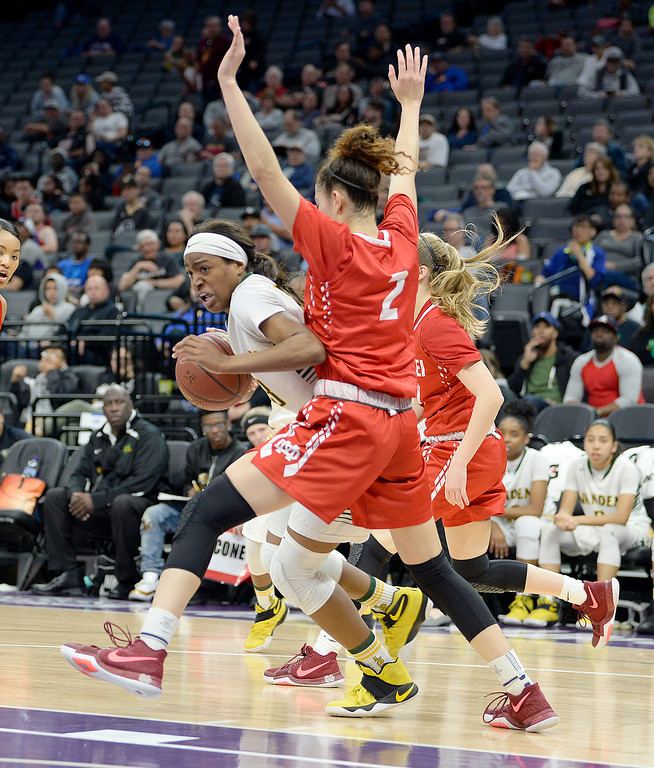 . Vanden\'s Julia Blackshell-Fair fights past the pressure of Mater Dei\'s Jayda Adams as she drives to the basket during the third quarter. Blackshell-Fair scored 20 points during the championship victory. Joel Rosenbaum -- The Reporter