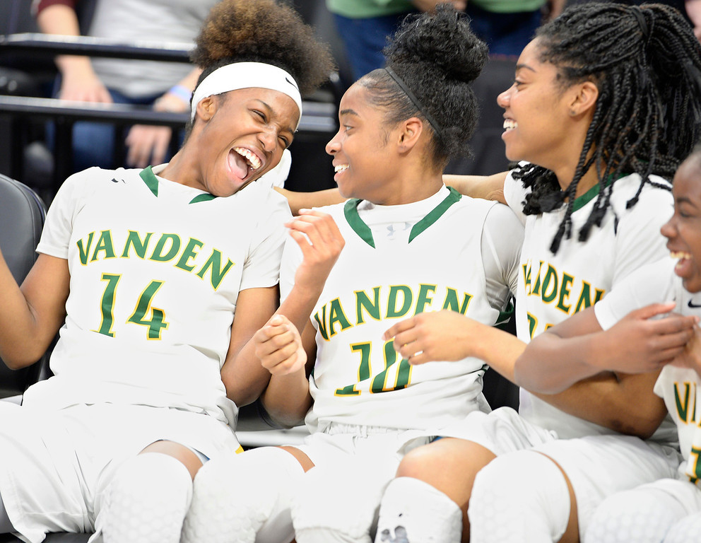 . Vanden\'s Aryel Moreland (left,) Derreca Sims (middle,) Kaelee Campbell celebrate their 64-61 victory over Mater Dei High School in  the CIF Girls Division II State Championships. Joel Rosenbaum -- The Reporter