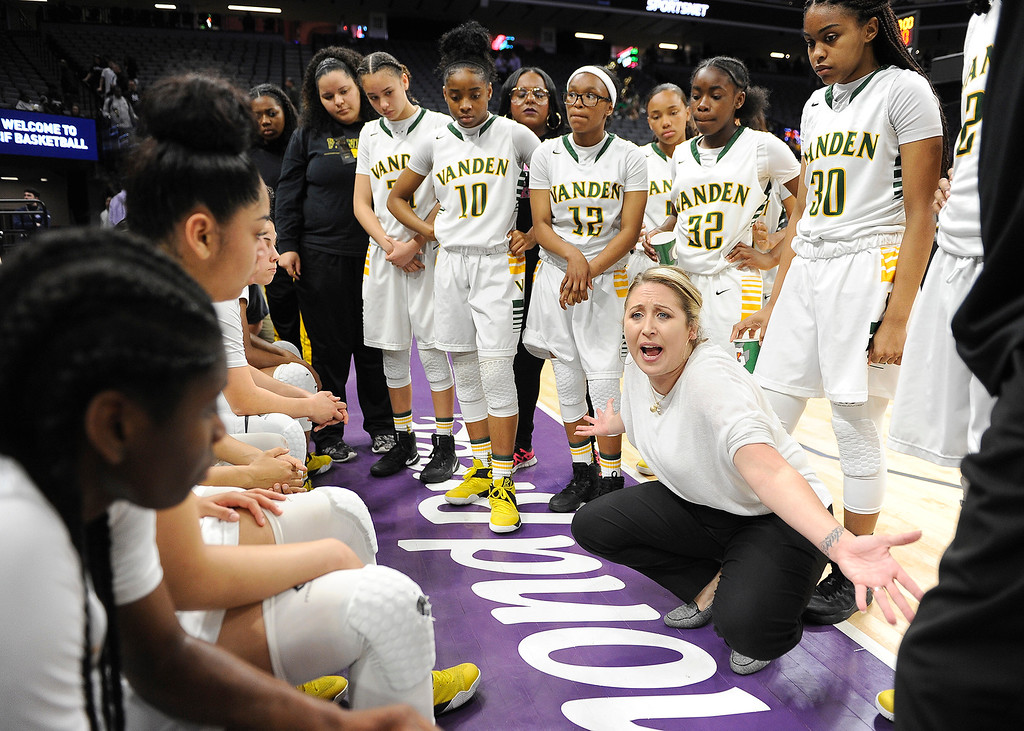 . Vanden co-head coach Allison Johnson fires up her players during a timeout late in the third quarter. The Vikings out-scored Mater Dei High 26-6 in the fourth quarter to overcome a 17-point deficit to win their first state title. Joel Rosenbaum -- The Reporter