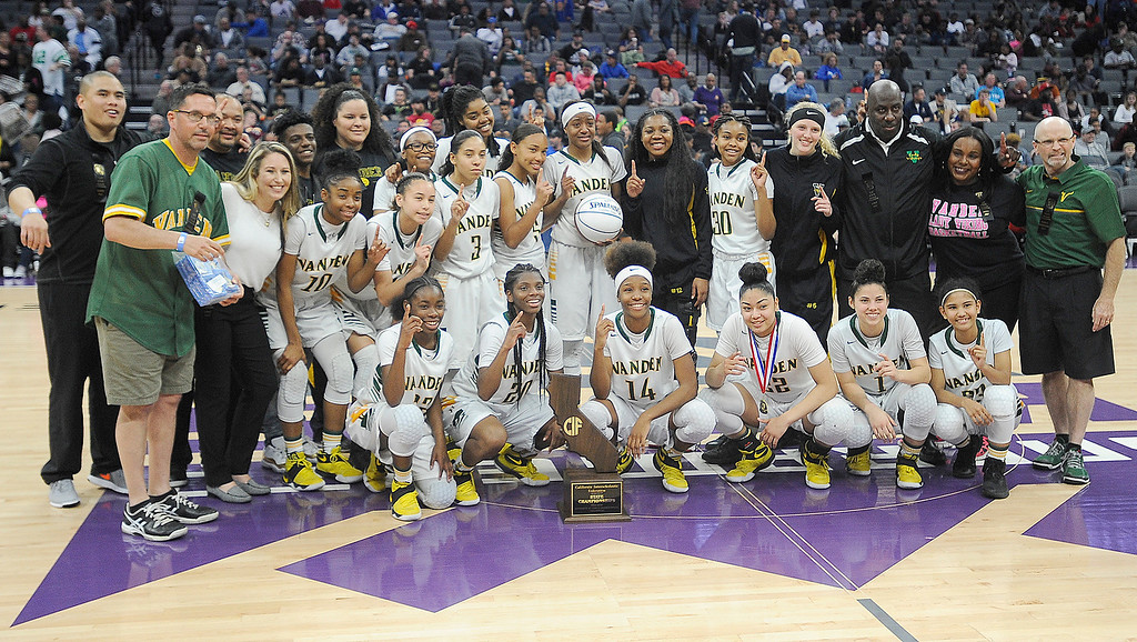 . The Vanden Viking girls basketball team pose with the state champion trophy. Joel Rosenbaum -- The Reporter