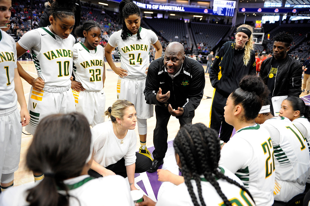 . Vanden co-head coach Jake Johnson talks with the team during a time out late in the fourth quarter of the Vikings 64-61 victory in the CIF Girls Division II State Championship Saturday at the Golden 1 Center in Sacramento. Joel Rosenbaum -- The Reporter