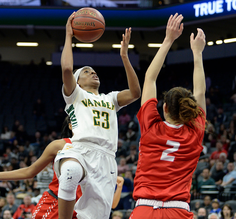 . Vanden�s Julia Blackshell-Fair drives to the basket over the pressure of Mater Dei�s Jayda Adams to give Vikings the lead with 11 seconds left in the fourth quarter of the Vikings 64-61 victory over the Monarchs in the CIF Girls Division II State Championships Saturday at Golden 1 Center in Sacaramento. Joel Rosenbaum -- The Reporter